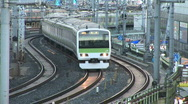 Commuter train passes at Ueno Train Station in Tokyo Stock Footage