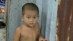 An Asian Boy In The Slums - stock footage