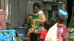 Asian Kids Buy A Snack In The Slums Stock Footage
