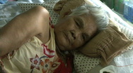 Stock Video Footage of Frail Old Asian Lady Laying Down In Bed