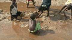 Malawi: african children play with water and sand 2 Stock Footage