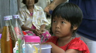 Little Asian Girl Waiting For Sweet Ice Snack Stock Footage