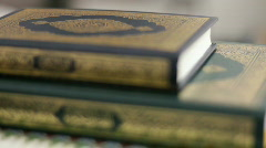 Stack of Holy Quran's on top of each other Stock Footage