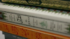 Stack of Holy Qurans on top of each other Stock Footage