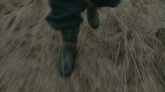 Walk in the  field in gumboots Stock Footage
