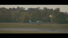 Small Plane Landing at Airport - stock footage