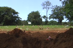 Stock Video Footage of Open Grave awaiting for Coffin - Burial Casket 1