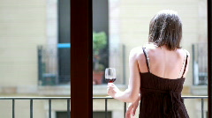 Woman tasting wine on the balcony Stock Footage