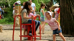 Little girls on the merry-go-round Stock Footage
