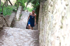 Woman walking up the stone stairs, shot in 60 fps, Park Guell, Barcelona Stock Footage