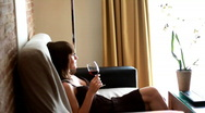 Woman relaxing on sofa with wine glass Stock Footage
