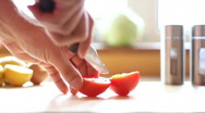 Slicing tomato, shot at 60fps Stock Footage