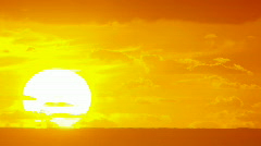 Big Sun Rise Over Ocean -  Sunrise Time Lapse - stock footage
