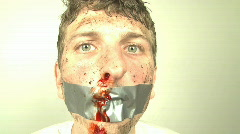 Overexposed man with Duct Tape on face Stock Footage