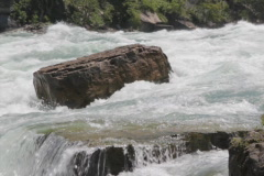 Rock in powerful river rapids. SD. Stock Footage