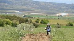 Boy on dirt bike P HD 0844 Stock Footage