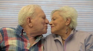 Senior Couple Kiss Stock Footage