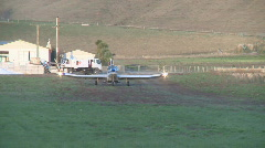 Cropduster takeoff from farm runway Stock Footage
