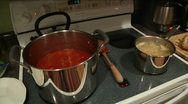 Stock Video Footage of spaghetti cooking on stove rev