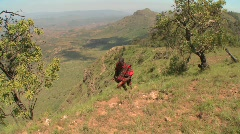 A Masai warrior walks along the edge of the world in Northern Kenya. Stock Footage