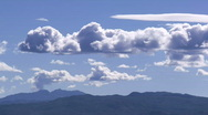 Mountains with the clouds moving over them time lapse Stock Footage