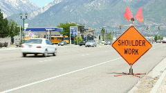 Road construction shoulder work sign  Stock Footage
