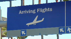 Pan across airport arrival/departure signs Stock Footage