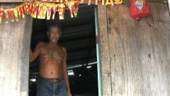 Old Asian Man Standing In The Doorway Stock Footage