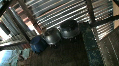 Old Pots And Lids In A Slum Home Stock Footage