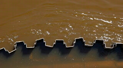 Dirty water on bridge pillar Stock Footage
