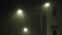 Illuminated street light in rain at night Stock Footage