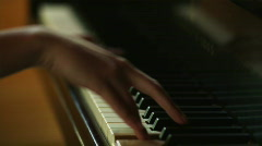 Woman's hands playing piano Stock Footage