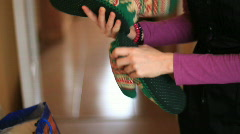 Girl takes out candy of Christmas sock Stock Footage
