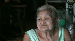 Sad Old Asian Lady Smiles For Camera Stock Footage