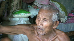 Old Asian Man Talking In The Slums Stock Footage