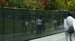People walking along Memorial Wall Stock Footage
