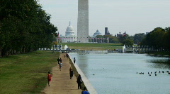 People on footpath along reflecting pool Stock Footage