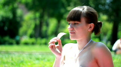 Woman eating potato chips outdoors Stock Footage