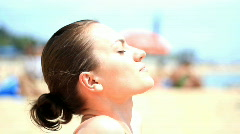 Young woman on the beach during sunbath  Stock Footage