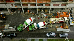 Cars passing construction site with cement mixers Stock Footage