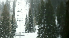Ski lift between forest/ Little Cottonwood Canyon Stock Footage