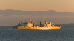 Military, Navy supply ship at sunset Stock Footage