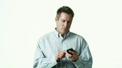 Man shouting during text-messaging against white background Orem Stock Footage