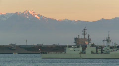Military, aircraft carrier and frigate at sunset Stock Footage