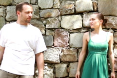 Couple standing against a wall and holding hands - stock footage