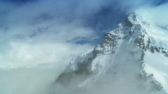 T/lapse Clouds on Swiss Mountains Stock Footage