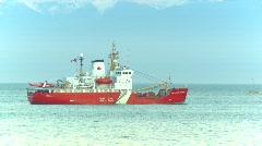 Coast Guard ship at dusk Stock Footage