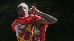 A Masai man in tribal costume talks on a cell phone. Stock Footage