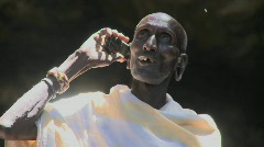 An old Masai man speaks to friends on a cell phone. - stock footage
