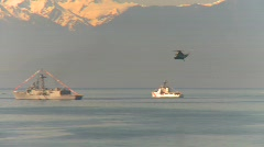 military, navy, Seaking helicopter, #8 over flotilla - stock footage